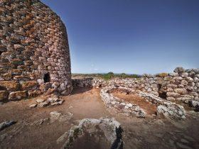 A historical castle near rock formations under the clear sky in Su Nuraxi, Sardinia, Italy
