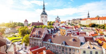 Cityscape aerial view on the old town with saint Nicholas church tower and Toompea hill in Tallin, Estonia